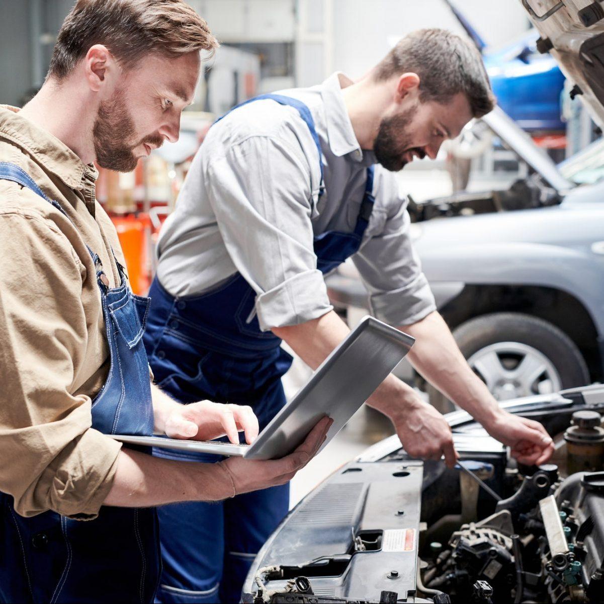 Mechanics Working in Car Service